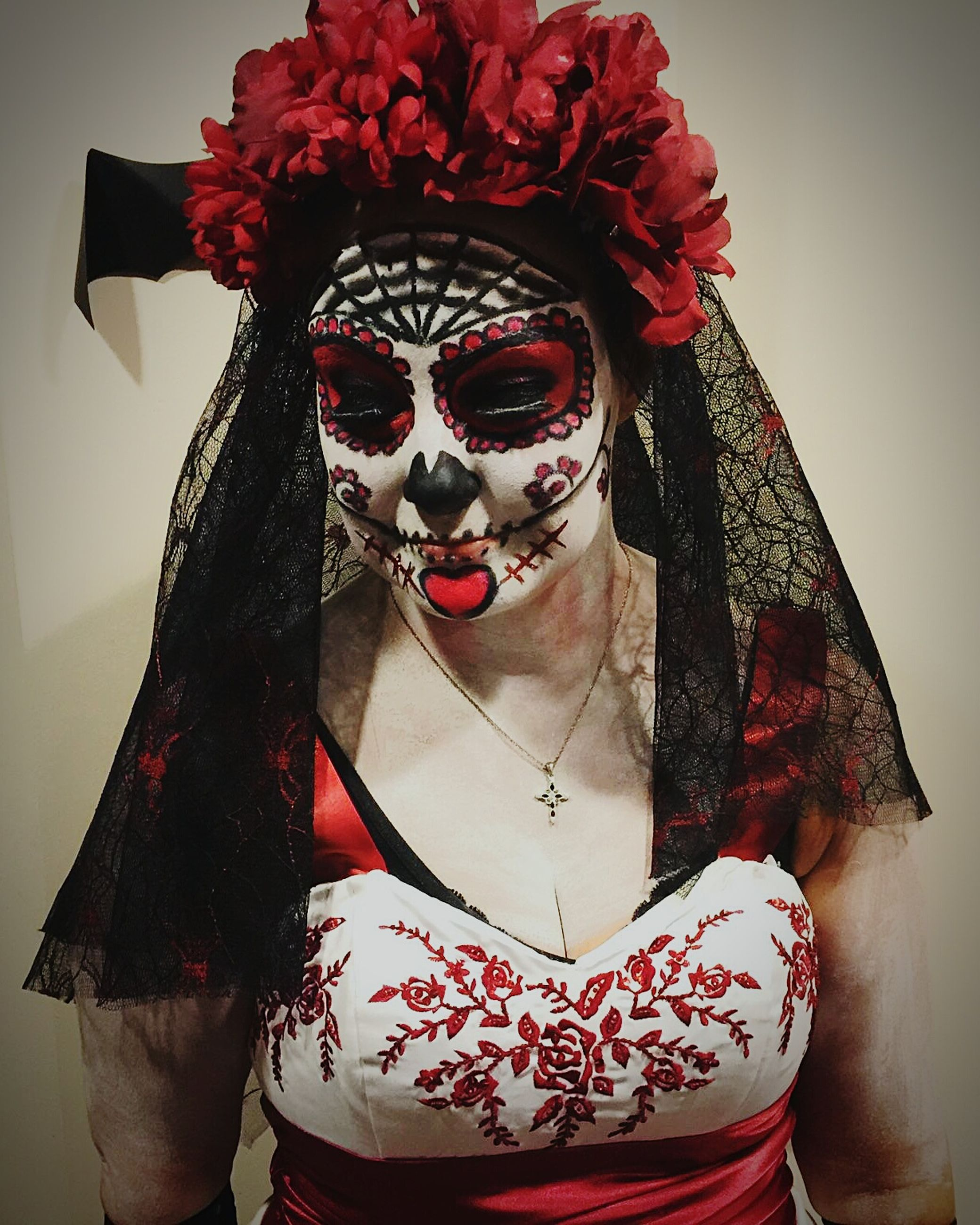 portrait, looking at camera, human representation, art, art and craft, creativity, front view, red, mask - disguise, indoors, tradition, close-up, sculpture, cultures, young adult, celebration, costume, statue