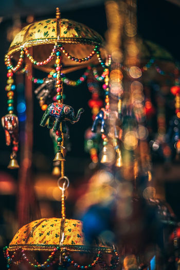 Close-up of decorations hanging for sale at market stall