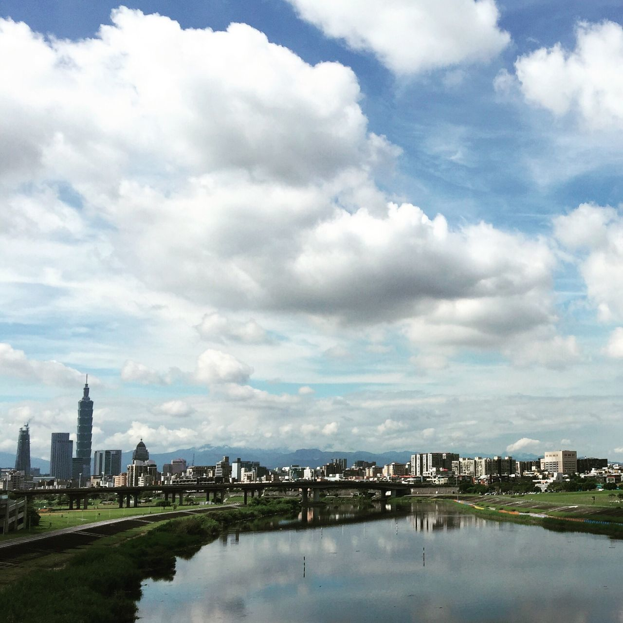 architecture, cloud - sky, sky, building exterior, built structure, city, skyscraper, modern, travel destinations, tower, cityscape, no people, day, reflection, waterfront, outdoors, water, urban skyline, growth, nature, tree