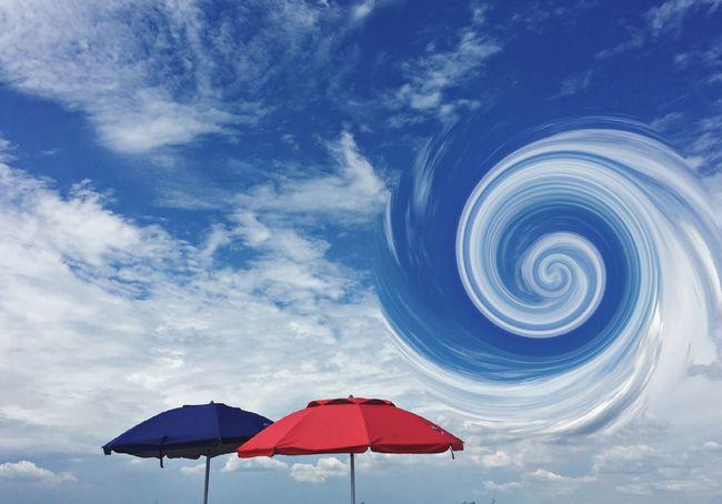 Abstract Swirled Sky Beachumbrellas