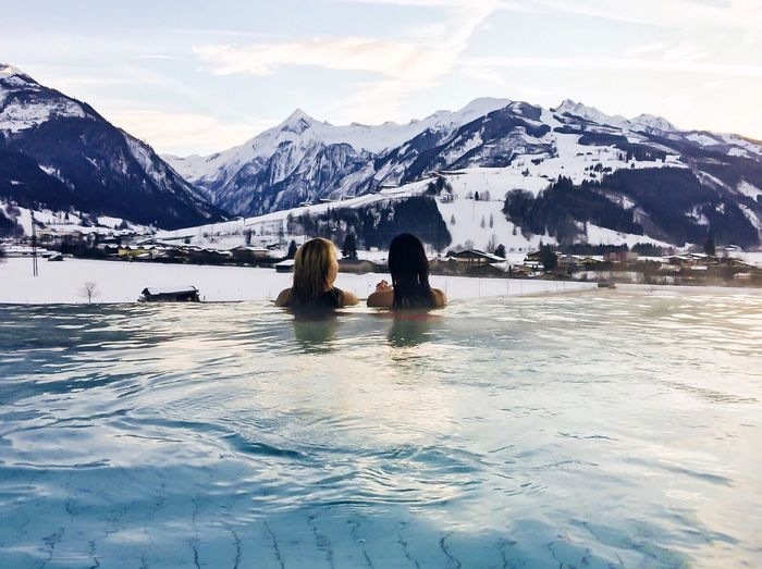 Infinity Pool Tauernspa Kaprun Spa Therme BergeTwo People Togetherness Women Adult Mountain Snow Adults Only Leisure Activity Mature Women People Day Landscape Outdoors Cold Temperature Young Women Nature Men Young Adult Sky Water