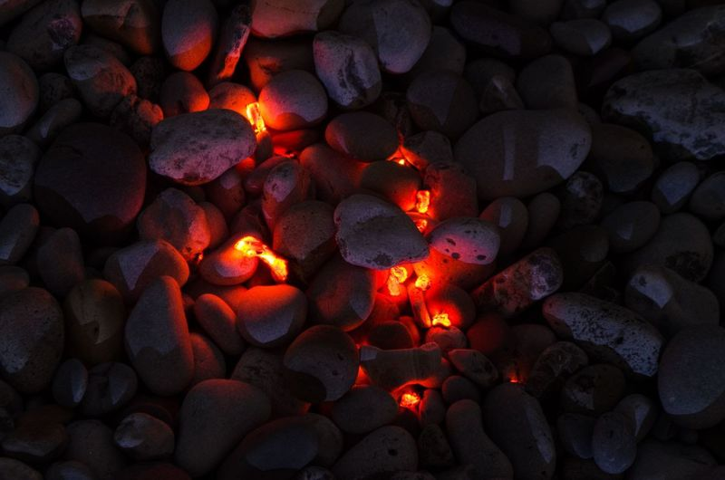 Burning Nikon Abundance Backgrounds Burning Close-up Fire Fire - Natural Phenomenon Flame Full Frame Glowing Heat - Temperature Illuminated Inspiration Large Group Of Objects Nature Night No People Orange Color Outdoors Pebble Rock Solid Stone - Object Stones