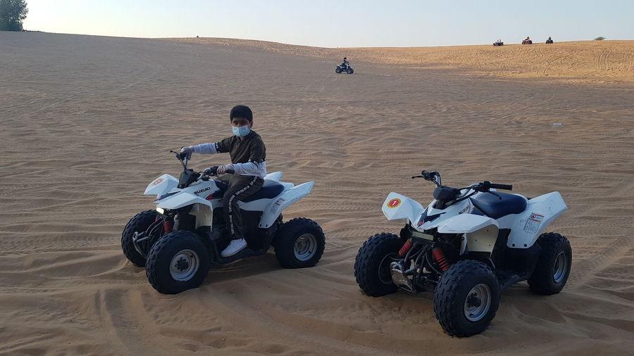 People sitting in desert