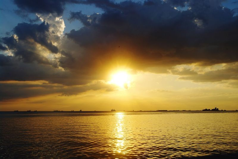 The beauty of the golden hour Getty Images EyeEm Selects Manila Bay  Water Sea Sunset Beauty Nautical Vessel Gold Colored Gold Multi Colored Sun Sunlight Seascape Dramatic Sky Horizon Over Water Moody Sky Calm Romantic Sky