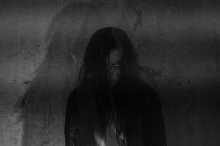 Double Exposure One Person Long Hair Emotion Indoors  Young Adult Adult Wall - Building Feature Women Fear Hair Real People Lifestyles Front View Portrait Horror Hairstyle Dark Sadness Depression - Sadness Scary Scary Face Spooky Atmosphere Ghost Monochrome