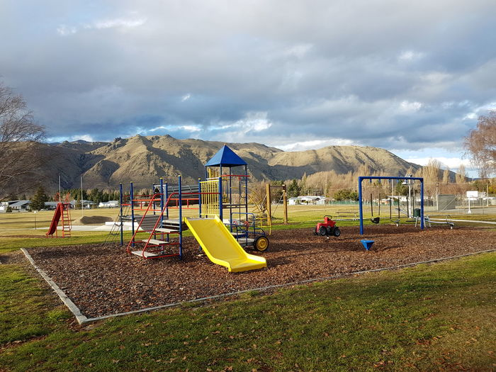Playground.. Scenics Playground Cloud - Sky Childhood Day Sky Outdoors No People Travel Destinations Green Color Tourism Travel Vacations Landscape Let's Go. Together. Mountain Beauty In Nature Freshness Children Only Outdoor Play Equipment Child