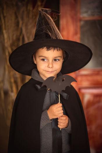Close-up of boy wearing batman costume