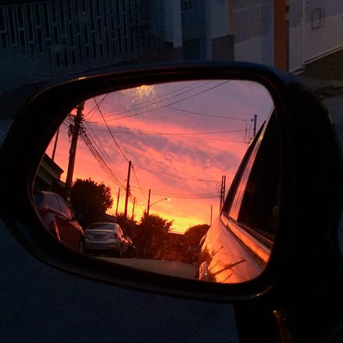 Sunset Transportation Land Vehicle Reflection Side-view Mirror Car Mode Of Transport Sky Close-up Street Road Street Light Orange Color Cloud - Sky Outdoors Vehicle Majestic No People Cloudy