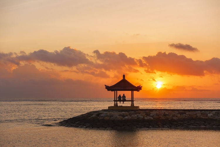 Beautiful Scenery at Karang Beach, Sanur, Bali, Indonesia Bali, Indonesia Holiday Architecture Beach Beauty In Nature Built Structure Cloud - Sky Horizon Horizon Over Water Idyllic Land Nature Orange Color Outdoors Sanur Beach Scenics - Nature Sea Silhouette Sky Sunset Tranquil Scene Tranquility Travel Destinations Vacation Water
