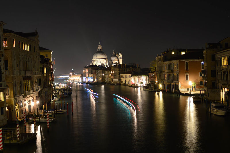 Santa Maria Della Salute By Grand Canal Against Sky At Night