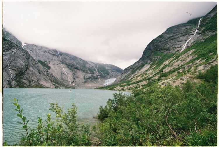 This is photo was shot on film near glacier in Norway. Beauty In Nature Day Growth Lake Landscape Mountain Nature No People Norway Outdoors Plant Scenics Sky Sreams Tranquil Scene Tranquility Tree Water