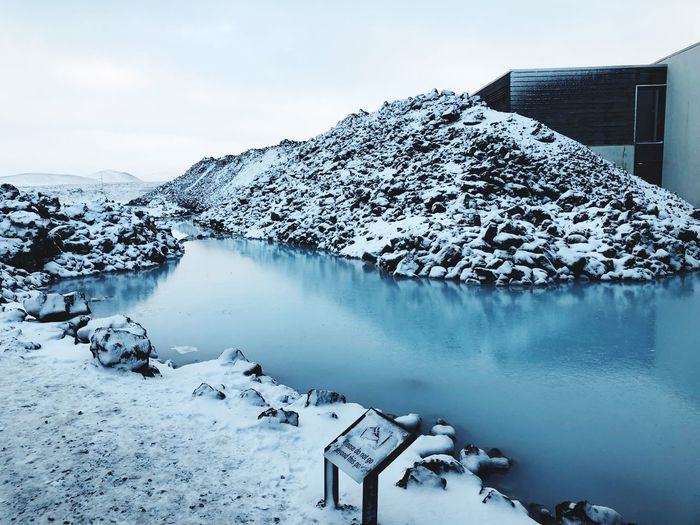 Scenic view of snow covered lake against sky