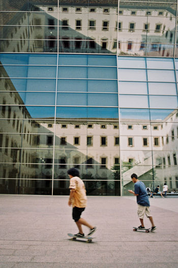 #urbanana: The Urban Playground 35mm Film Analogue Photography Barcelona SPAIN Skateboarding Youth Building Building Exterior Built Structure City Day Glass - Material Modern Office Building Exterior People Skyscraper Two People Youth Culture