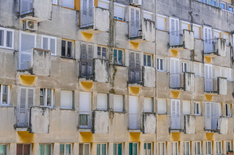 Built Structure Architecture Full Frame Building Exterior In A Row No People Side By Side Building Window Repetition Backgrounds Day Outdoors Residential District Pattern Order Large Group Of Objects Wall - Building Feature Low Angle View Arrangement Apartment