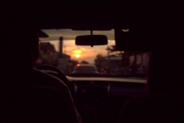 Sunset seen through train windshield