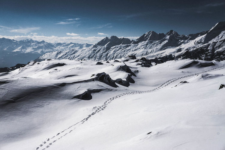 Follow my Footsteps Footsteps Footpath Tranquility Day Powder Snow Mountain Peak No People White Color Non-urban Scene Landscape Mountain Range Tranquil Scene Environment Snowcapped Mountain Beauty In Nature Scenics - Nature Mountain Snow Cold Temperature Winter