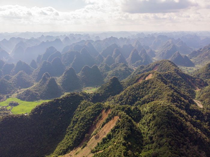 Scenic view of mountain range against cloudy sky in vietnam