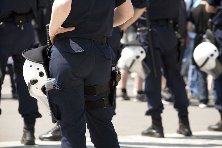Police officers on duty. Counter-terrorism. State of emergency. Adult Day Outdoors People Weapon