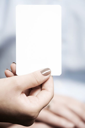Cropped Hand Of Woman Holding Blank Business Card