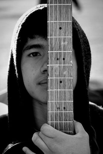 Close-up portrait of man holding guitar