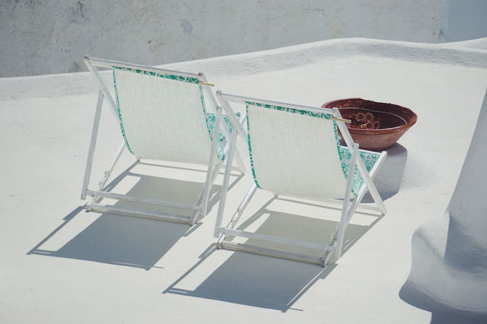 on the rooftop White White Color White Album Roof Rooftop Roof Tile Rooftops Chair Chairs Sundeck Greece Whitewashed Close-up