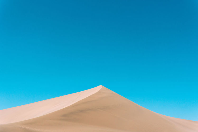 Desert Simplicity Minimalism Colorful Blue Sand Dune No People Peaceful Dandelion FAR AWAY The Minimalist - 2019 EyeEm Awards