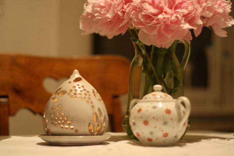 Close-up of roses in vase on table at home