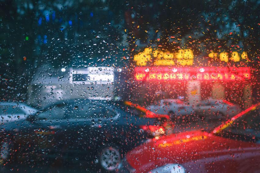 Wet with rain street through the glass of the car Backgrounds Car Car Interior Close-up Drop Glass - Material Illuminated Jam Land Vehicle Mode Of Transport Night No People Rain RainDrop Rainy Season Road Street Traffic Transportation Travel Vehicle Interior Water Weather Wet Window