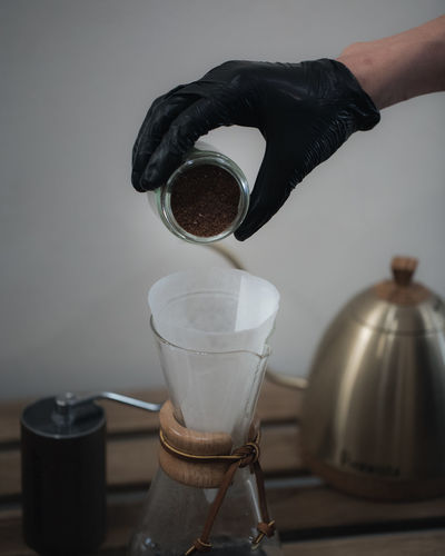 Coffee Brewing and Coffee Making Ijas Muhammed Photography Human Hand Hand Human Body Part Food And Drink Coffee One Person Indoors  Real People Holding Pouring Drink Coffee - Drink Unrecognizable Person Refreshment Coffee Maker Cup Preparation  Close-up Body Part Coffee Pot Finger Glass