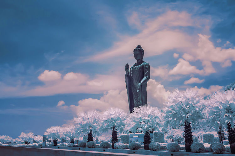 Statue against sky during winter