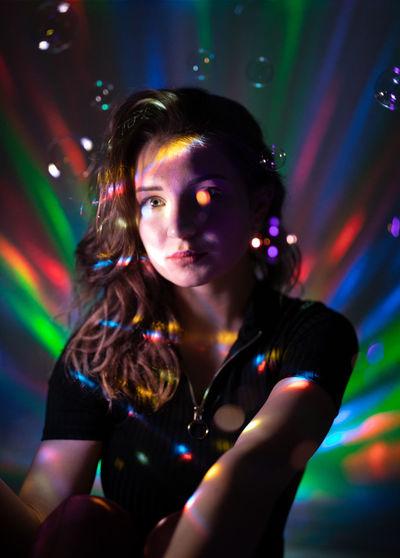 Portrait of woman in illuminated nightclub