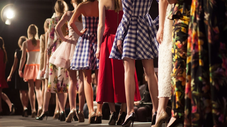 Fashion Models Walking On Catwalk