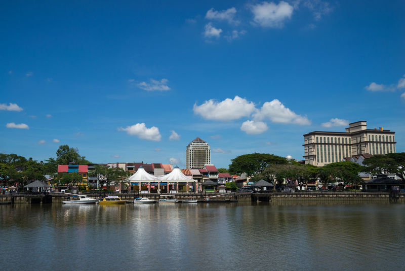Kuching, capital of state of Sarawak, is a diverse city of old colonial and modern buildings with Sarawak River waterfront in the middle. Borneo Built Structure Cityscapes Clouds And Sky Development Kuching Malaysia Reflection Riverside Rural Sarawak Town Urban Landscape