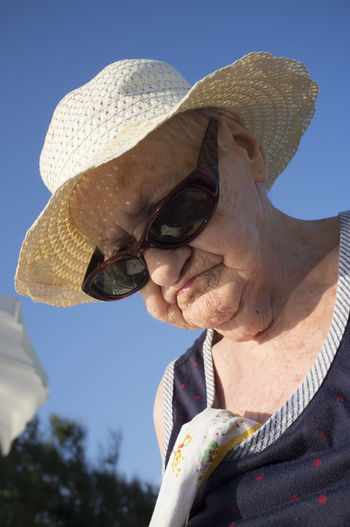Low angle view of senior woman wearing hat