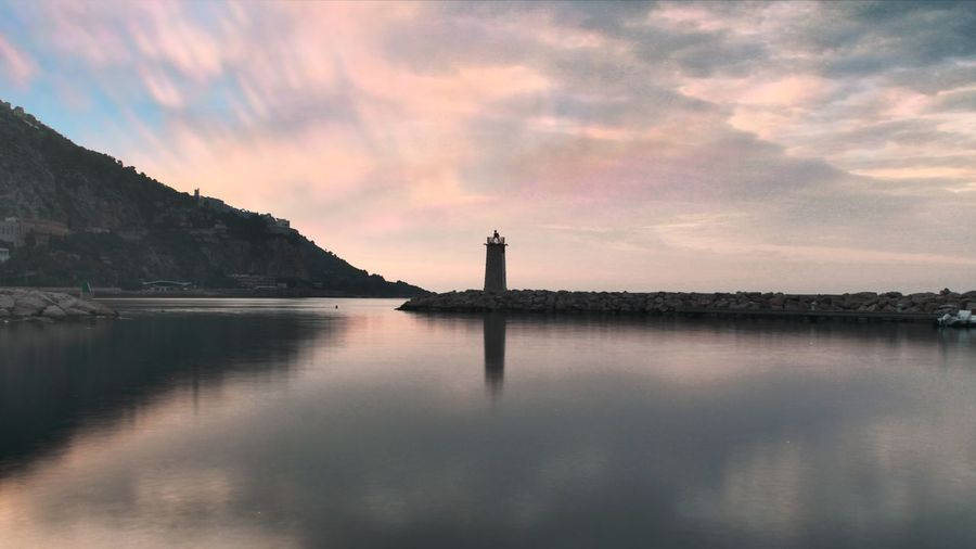Lighthouse Water Sunset Lake Reflection Nautical Vessel Sky Horizon Over Water Pomeranian Romantic Sky Dramatic Sky Atmospheric Mood Tranquil Scene Scenics Moody Sky