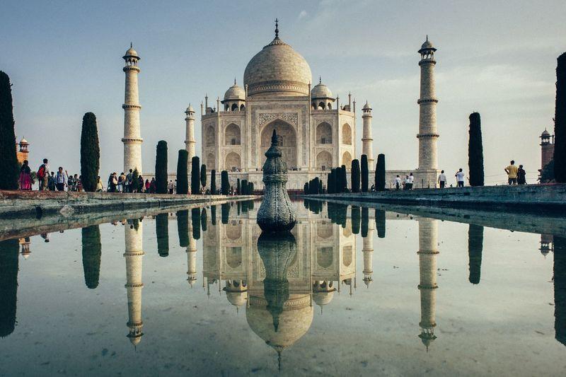 Reflection of taj mahal against clear sky