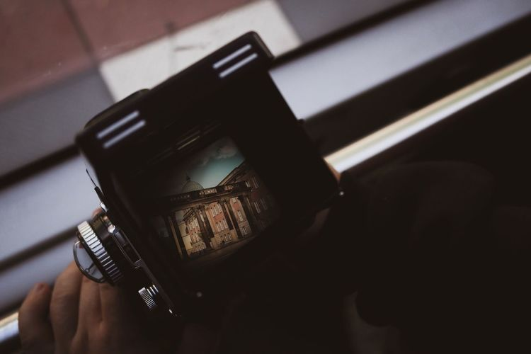 Vintage Photo Palace Analog Photography Vintage Technology Photography Themes Wireless Technology One Person Holding Mobile Phone Human Body Part Photographing Communication Hand Human Hand Portable Information Device Screen Close-up Lifestyles Connection Activity Digital Camera Autumn Mood