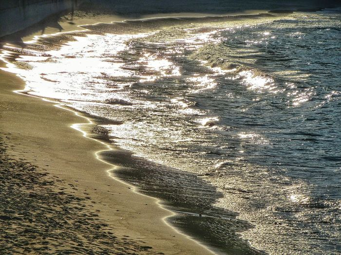 Golden sunset waves Beauty In Nature Coastline Day Diminishing Perspective Idyllic Landscape Lumicar Nature No People Non-urban Scene Ocean Outdoors Remote Rippled Scenics Sea Landscape Shore The Way Forward Tourism Tranquil Scene Tranquility Water The Essence Of Summer