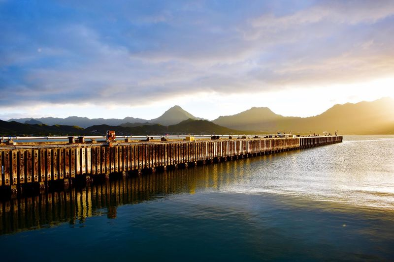 Pier at sunset on Marine Corps Base Hawaii Pier Hawaii Mountain Sky Water Cloud - Sky Mountain Range Scenics Beauty In Nature Tranquil Scene Nature Reflection Outdoors Sea Tranquility No People Waterfront Sunset Sunlight Day Architecture