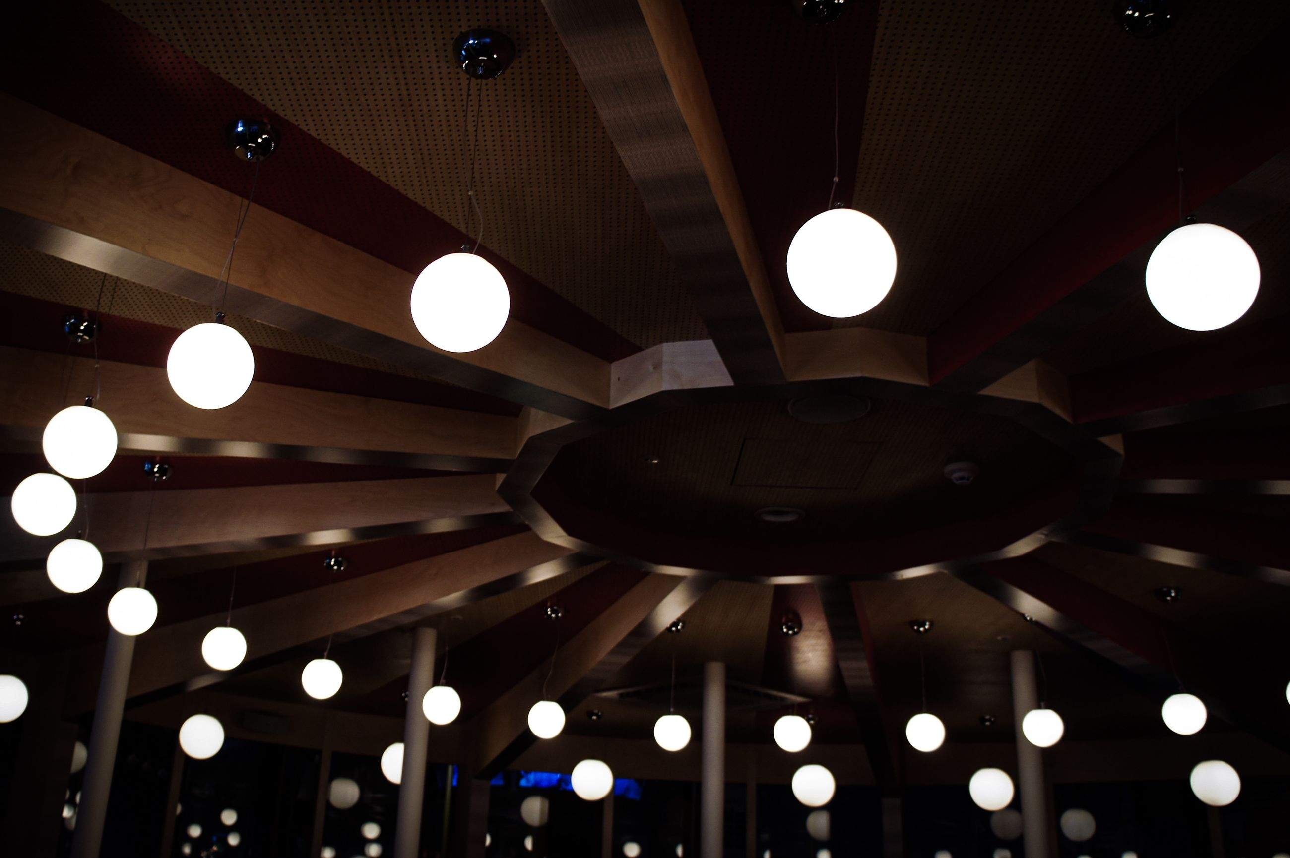 illuminated, lighting equipment, ceiling, low angle view, indoors, light, hanging, electric light, technology, glowing, electricity, no people, light - natural phenomenon, pattern, decoration, architecture, pendant light, light fixture, built structure, geometric shape, electric lamp, luxury