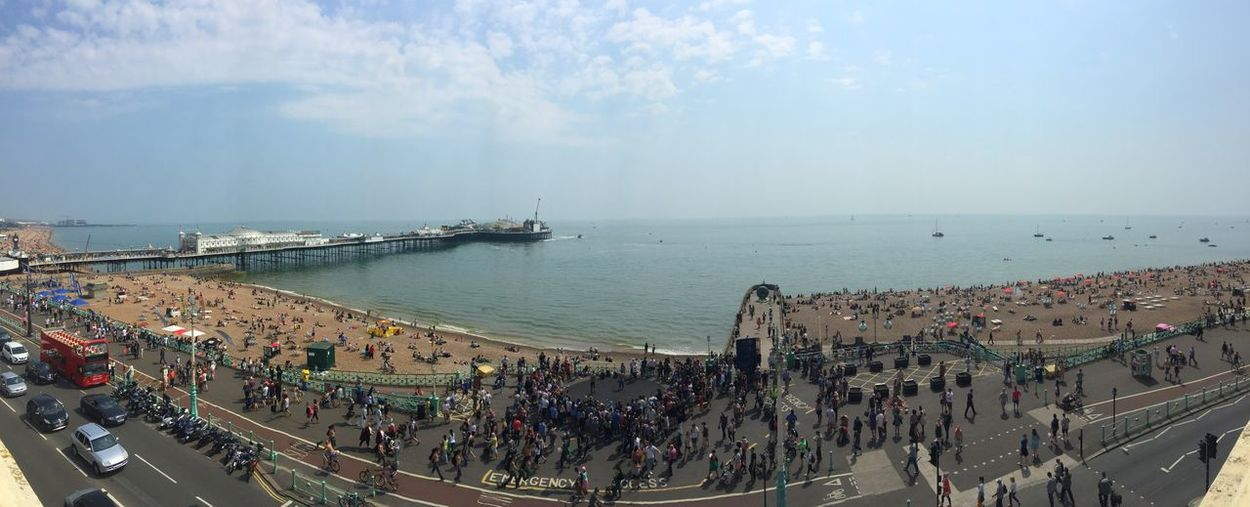 High angle view of crowd by sea against sky