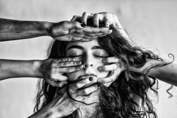 Cropped Image Of Hands Hitting Woman