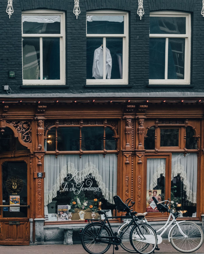 BICYCLES ON STREET BY BUILDING