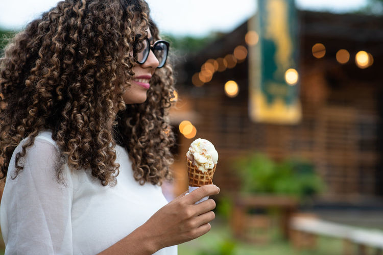 Midsection of woman holding ice cream
