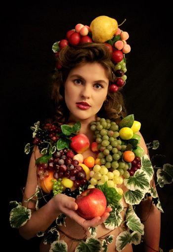 Temptress Fruits Girl Studio Photography Blackbackground Woman Sin  Temptation IPhoneography Iphoneonly Paradise Apple Healthy Eating Healthy Lifestyle Bunch Freshness Innocence IPS2016People Paradise Women Around The World