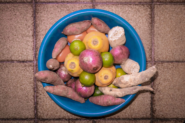 Directly above shot of vegetables and fruits in plastic container at home