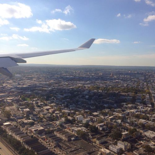Welcome to NYC Part Of Air Vehicle Flying Airplane Aircraft Wing Cropped Mode Of Transport On The Move Transportation Sky Landscape Aerial View Mid-air Travel City Cityscape Cloud Cloud - Sky Horizon Over Land Airplane Wing Nyc