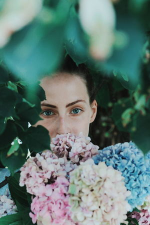 hidden Flowers Nature Photography Nature Plant Woman Human Body Part EyeEm Selects Flower Florist Young Women Portrait Beautiful Woman Beauty Women Beautiful People Flower Head Looking At Camera Lilac Plant Life Rose - Flower In Bloom Botany Iris - Plant The Portraitist - 2018 EyeEm Awards