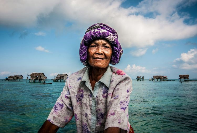 Portrait of senior woman against sea