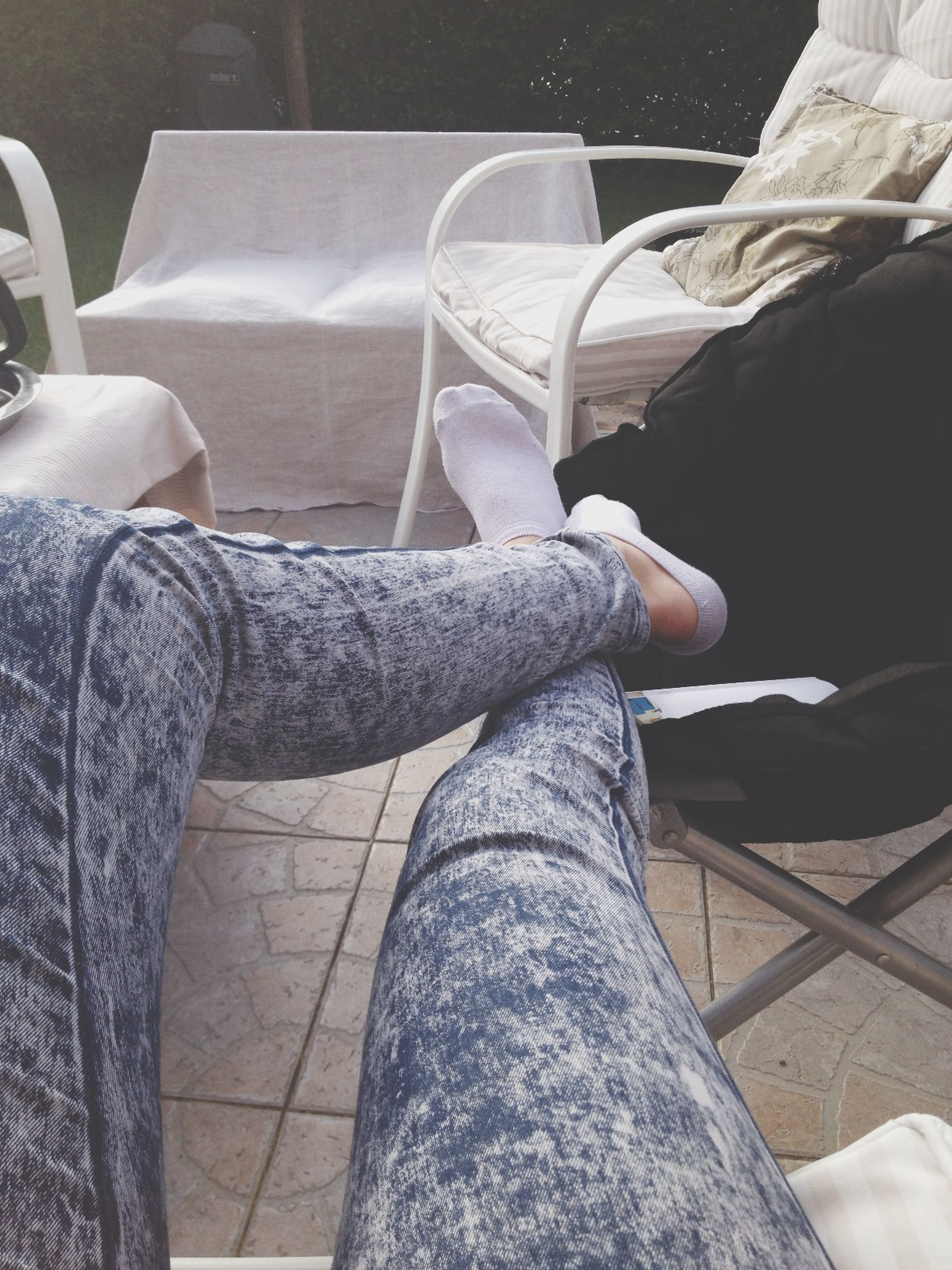 low section, person, jeans, shoe, indoors, personal perspective, men, part of, lifestyles, sitting, human foot, footwear, casual clothing, relaxation, close-up, legs crossed at ankle, standing